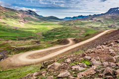 Winding mountain road leading to the valley Stock Photo