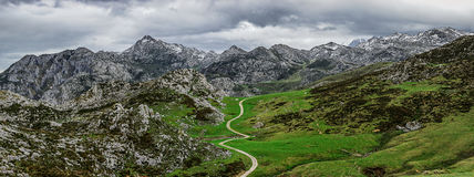 A winding mountain road. This is a panorama of the Picos de Europa mountains near the Lake Ercina at Covadonga Stock Photography
