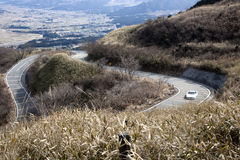 Winding mountain road with sports car Royalty Free Stock Images