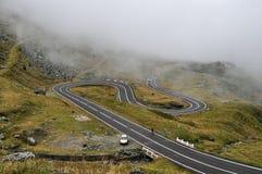 Winding mountain road Transfagarasan and fog in Romania. Winding mountain road Transfagarasan and fog in the Romanian Carpathians royalty free stock image
