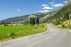 Desereted Winding Mountain Road on a Clear Summer Day Royalty Free Stock Photos