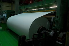 Winding of paper in a roll Royalty Free Stock Photos