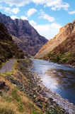 Winding Parallel Paths. A road winds alongside the Snake River through Hell's Canyon royalty free stock photos