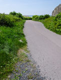Winding path. Down to the sea far away in the background Royalty Free Stock Image