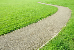 Winding Path in a Green Garden Royalty Free Stock Image