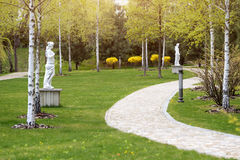 Winding path through the landscaped summer park. Green park outdoor Royalty Free Stock Images