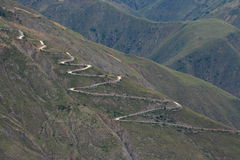 A winding path in mountains Stock Photo
