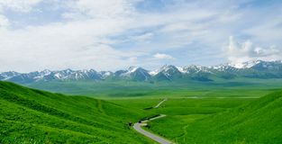 A winding path, it is to take us to Tianshan snow lotus road Stock Photo