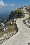 A winding path to the top of the mountain. The Mausoleum of Njegosh, Montenegro Royalty Free Stock Photo