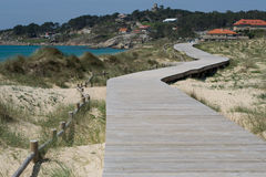 Winding Path. Winding wooden path along the Lanzada beach in Galicia Royalty Free Stock Photos