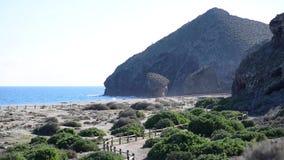 Winding pathway leading to the picturesque Playa de los Muertos beach. Spain