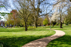Winding pathway. A winding path in a park area on a sunny day Stock Images