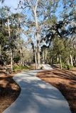 Winding Paved Bike Path Through Landscaping Royalty Free Stock Photography