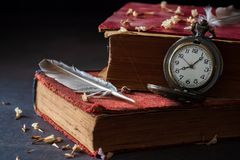 Free Winding Pocket Watch On Old Books With Feathers And Dried Flower Petals. Royalty Free Stock Photography - 145540767