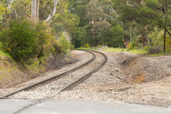 Winding railway track. A railway track curves around a bend in Aldgate, South Australia Stock Image