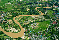 The winding river on green land. The Top view of Ping river in Chieng-mai Thailand stock image