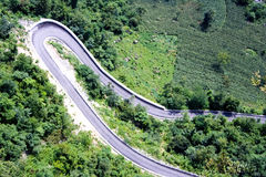 Winding road. A long winding road through the green vegetation,quite complicated and narrow.Taken in Enshi of China Stock Photos