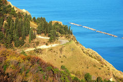 Winding road. Climbing on a spectacular hill facing the Adriatic sea in central Italy Stock Photography