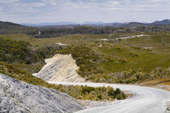 Winding Road. Gravel road snakes off into the distance stock images