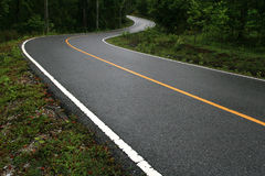 Winding Road. In Forest, Thailand Royalty Free Stock Images