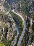 Winding road. Aerial view of a winding road through a canyon by a river Stock Images