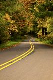 Winding Road. Asphalt road winding through the Oregon countryside that is displaying its seasonal colors Royalty Free Stock Image