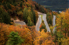 Winding Road. Sharp hairpin turns on a road that travels through a pass in the Italian Alps Stock Photos