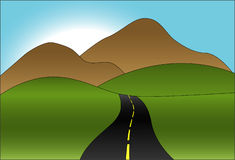 Winding Road. A winding road toward hills and mountains Stock Photography