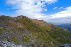 Winding road. Stilfser Joch: mountain pass in tirol. italy and switzerland. Pass height about 2700 meters. More than 40 hairpin bends royalty free stock photo