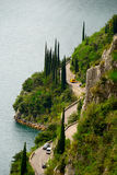 Winding road. Along the lake Garda at the western shore, where the mountains are steep stock images