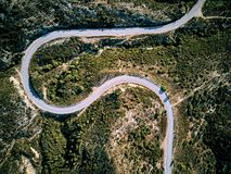 Winding road aerial view. Winding road top aerial view drone shot, Sithonia, Greece stock images