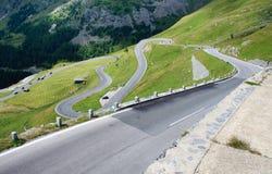 The winding road ahead. The winding alpine road ahead stock photos