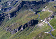 The winding road ahead. The winding alpine road and tunnel royalty free stock image
