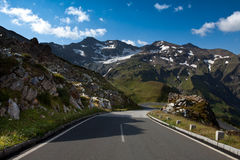 The winding road ahead. The winding alpine road ahead royalty free stock photo
