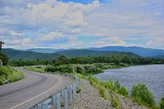 The road along the river and mountains. The Sikhote-Alin mountains. royalty free stock image