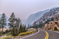 Winding road along mountainside Stock Image