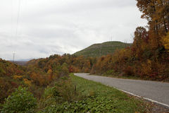 Winding road in Appalachia. A winding road through the Autumn landscape, Appalachia royalty free stock photos
