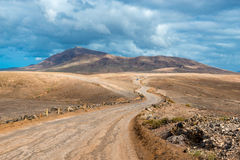 Winding Road in Arid Landscape on Lanzarote Stock Photo
