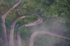 The Winding Road of Chinese Zhangjiajie Tianmen Mountain in the Mist Stock Images