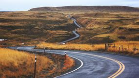 Winding road through countryside Stock Photography