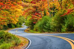 Free Winding Road Curves Through Autumn Foliage Trees In New England Royalty Free Stock Photo - 190256695