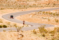 Winding road through the desert Royalty Free Stock Image