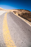Winding road in the desert Stock Images
