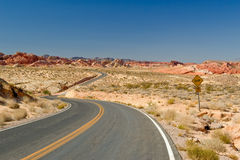 Winding road through desert Stock Image