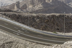 Winding road in desert mountain Stock Image
