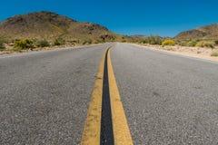 Winding Road Through Desert Terrain Royalty Free Stock Image