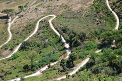 A winding road down a mountain in western Sicily Stock Photography