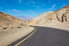 Winding Road in Dry Desert Stock Photo