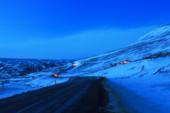 Winding road at dusk in winter. Northeast of Iceland. The Ring Road (Route 1) of Iceland, near  Egilsstadir Royalty Free Stock Image