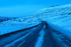 Winding road at dusk in winter. Winding road at dusk in winter, Northeast of Iceland. The Ring Road Route 1 of Iceland, near Egilsstadir Stock Images